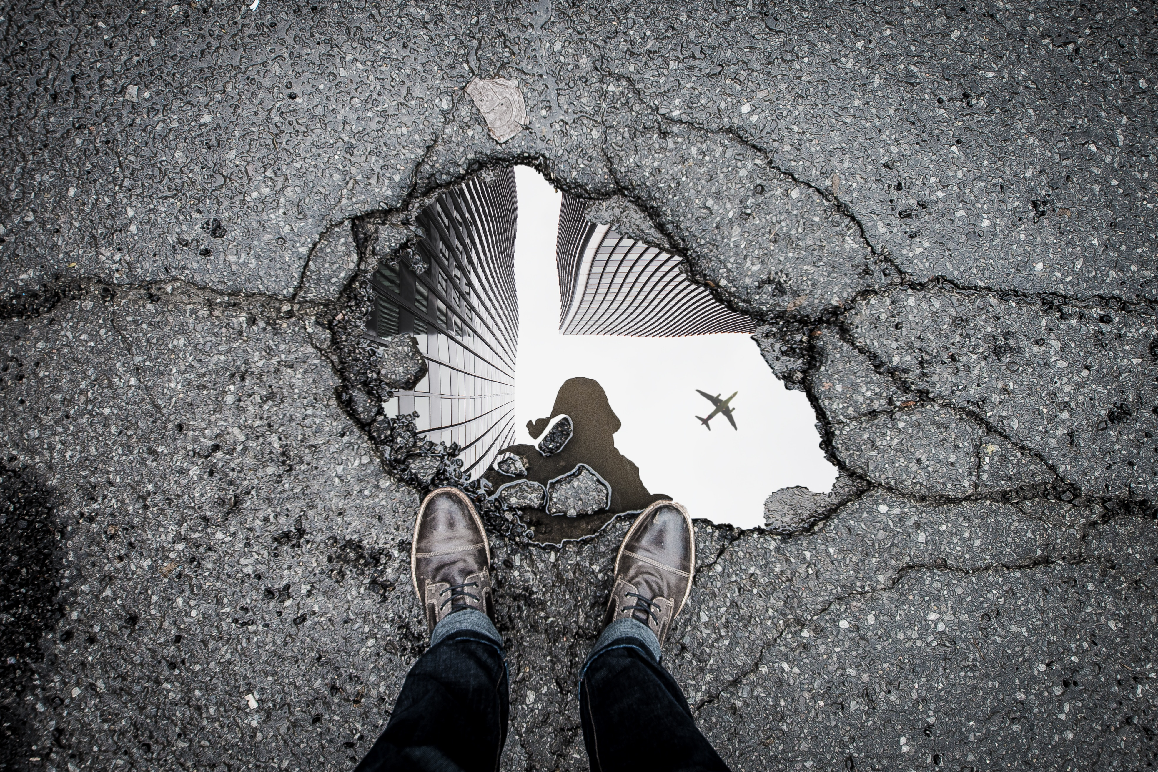 two feet beside a puddle