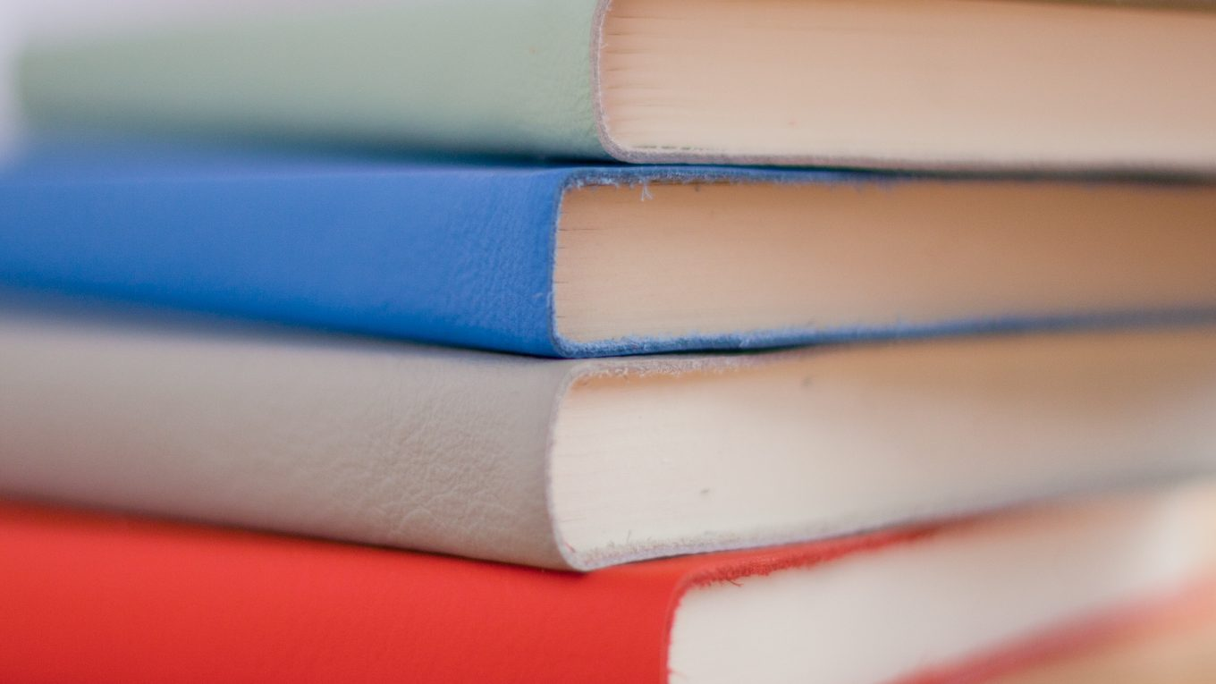 stack of notebooks in different colours