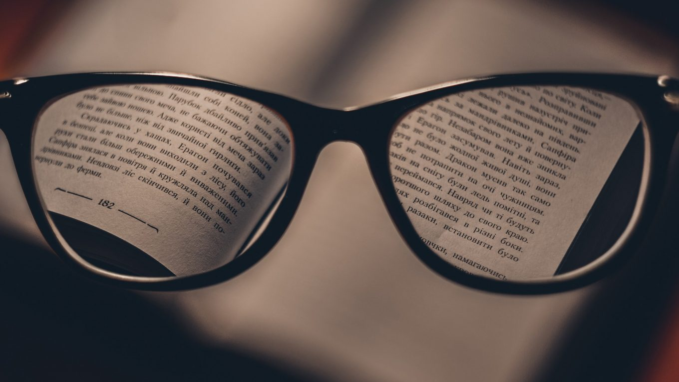 glasses resting on a book